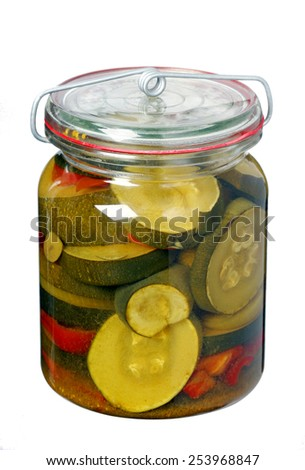 Glass jar with pickled zucchini isolated on white background - stock photo