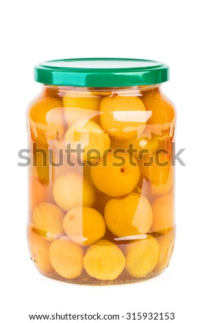Glass jar with preserved apricots isolated on white background - stock photo