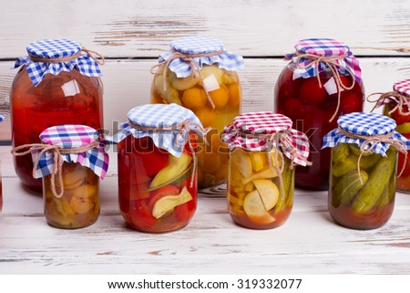 Glass jars with canned food. Beautiful glass jars of preserves. - stock photo