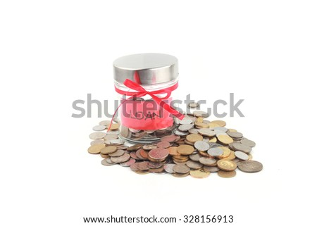 Glass jars with coins and loan label - stock photo