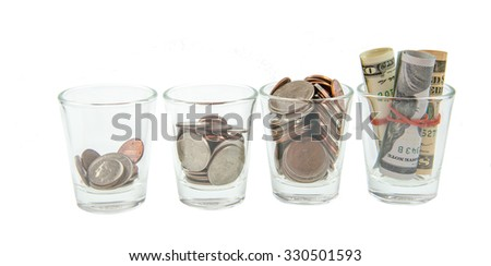 Glass jars with coins like diagram, - savings concept - stock photo