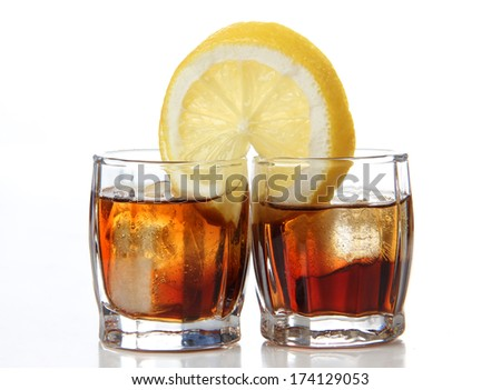 Glass jars with whiskey on a white background - stock photo