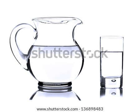 Glass jug and tumbler with water on white - stock photo