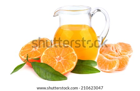 Glass jug with tangerines juice on white background - stock photo