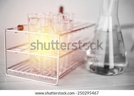 Glass laboratory chemical test tubes with liquid. Selective focus effect ; lighting effect vintage style - stock photo
