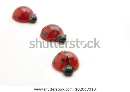 Glass ladybugs, isolated on white - stock photo