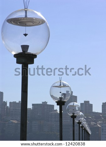 Glass lamps in a row - stock photo