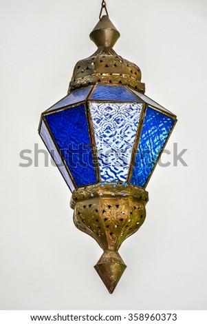 Glass lantern on a white background - stock photo