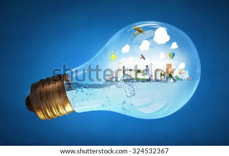 Glass light bulb with water and cityscape inside  - stock photo