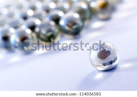 Glass marbles balls. The focus is on the first - stock photo
