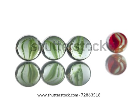 Glass marbles. Illustrating the odd one out concept. - stock photo