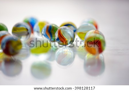 Glass marbles on gray background - stock photo