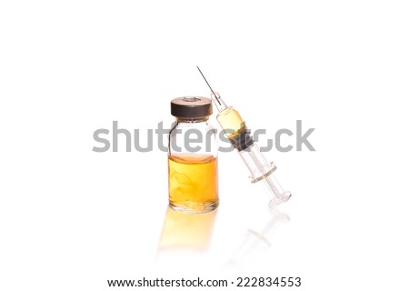 Glass Medicine Vial and glass syringe for Injecting medicine on a white background - stock photo