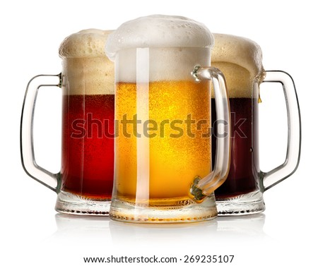 Glass mugs of beer isolated on a white background - stock photo