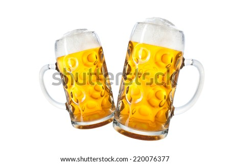 Glass mugs with beer isolated on white background - stock photo