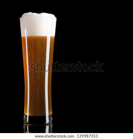 Glass of beer on a black background - stock photo