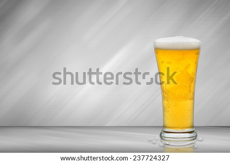 Glass of beer on a metal background - stock photo