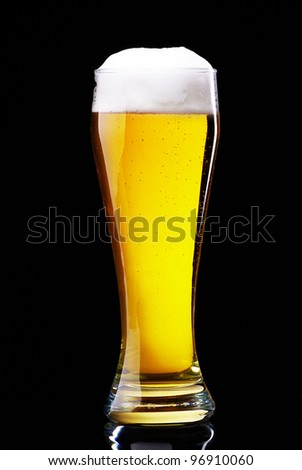 Glass of beer on black - stock photo