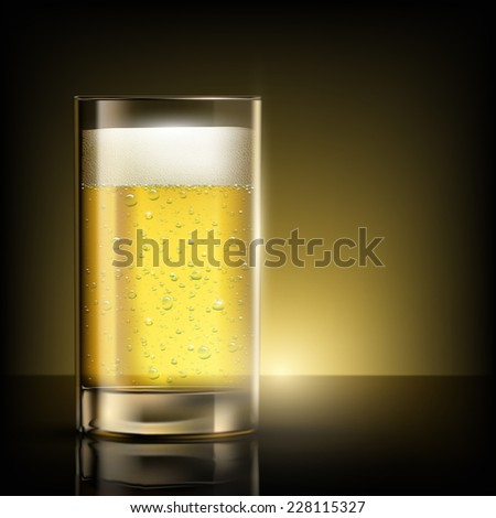 glass of beer standing on a table - stock photo