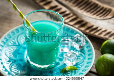 Glass of blue curacao and juice cocktail - stock photo