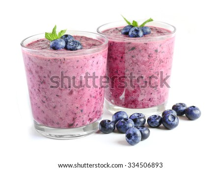 Glass of blueberry smoothie isolated on white - stock photo