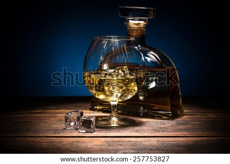 Glass of brandy and bottle  - stock photo