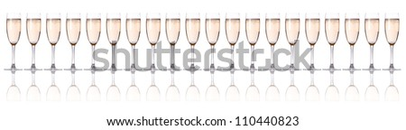 glass of champagne flutes on a white - stock photo