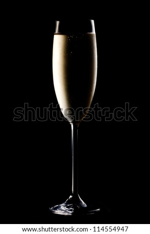 Glass of champagne on black background - stock photo