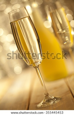 Glass of champagne on bokeh background - stock photo