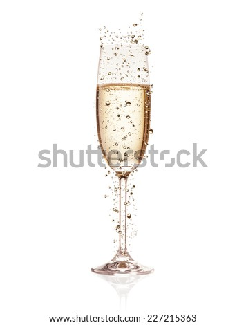 Glass of champagne with splash, isolated on white background - stock photo