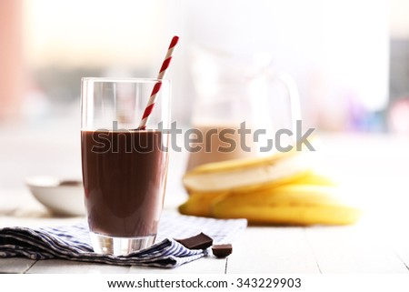 Glass of chocolate milk on table close-up - stock photo