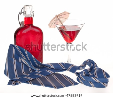 glass of cocktails, necktie and bottle on white - stock photo