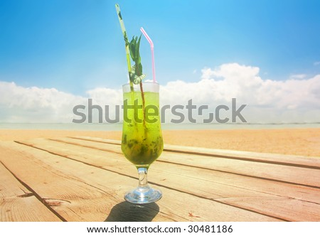 Glass of coctail of Mojito on wood table on blue sky background - stock photo