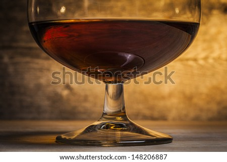 Glass of cognac  - stock photo