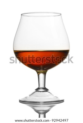 Glass of cognac isolated on white - stock photo