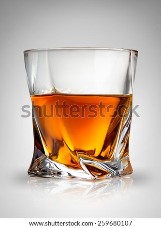 Glass of cognac on a gray background - stock photo