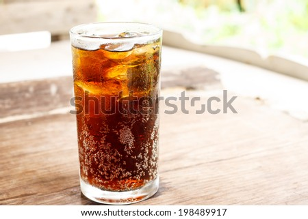 Glass of cola background texture - stock photo