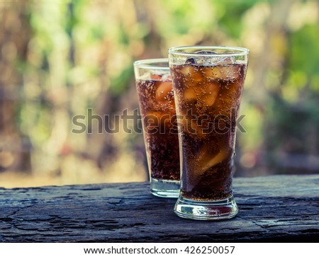 glass of cola with ice cubes,Drink Soda. - stock photo