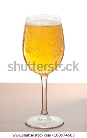 Glass of cold beer over wooden surface. - stock photo