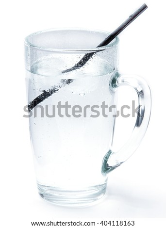 Glass of cold mineral soda water with ice cubes and a cocktail tube isolated on the white background. Mug with crystal clear drinking water, cold and refreshing drink.  - stock photo