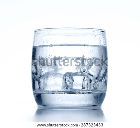 Glass of cold water and ice on background - stock photo