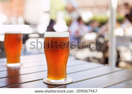 Glass of craft IPA beer on a table during beer festival in Belarus. India pale ale hoppy beer - stock photo