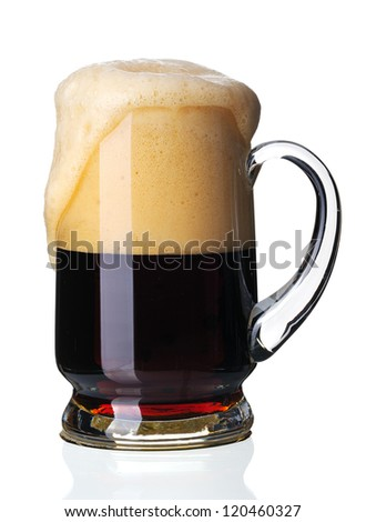 Glass of dark beer, isolated on a white background. - stock photo