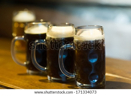 Glass of dark beer on a pub - stock photo