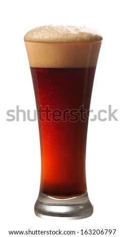 Glass of dark beer on white background - stock photo