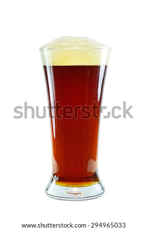 Glass of dark beer on white background. Brown ale with foam. - stock photo