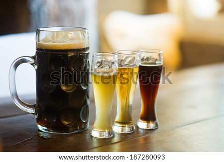 Glass of different types beer on a pub - stock photo