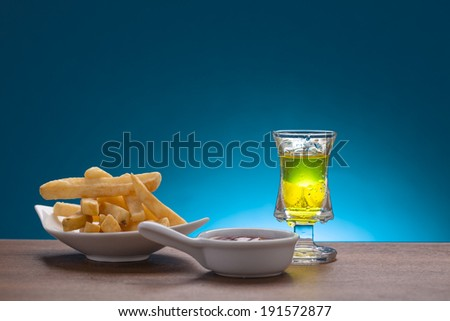 glass of drink with french fries and ketchup  - stock photo