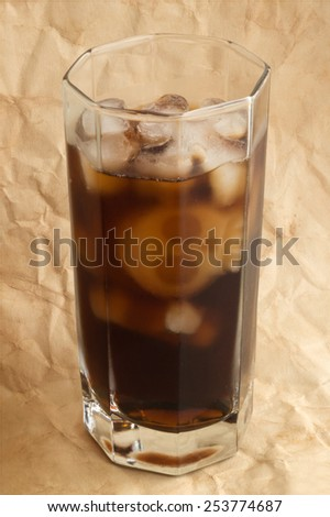 Glass of drink with skull and bones ice.  - stock photo