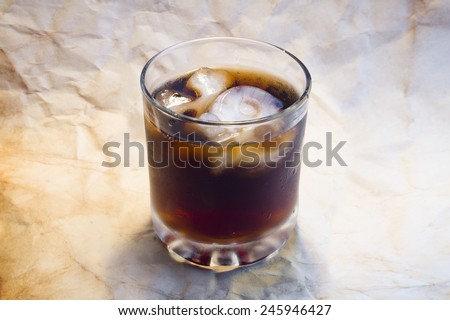 Glass of drink with skull and bones ice. Top side view. - stock photo